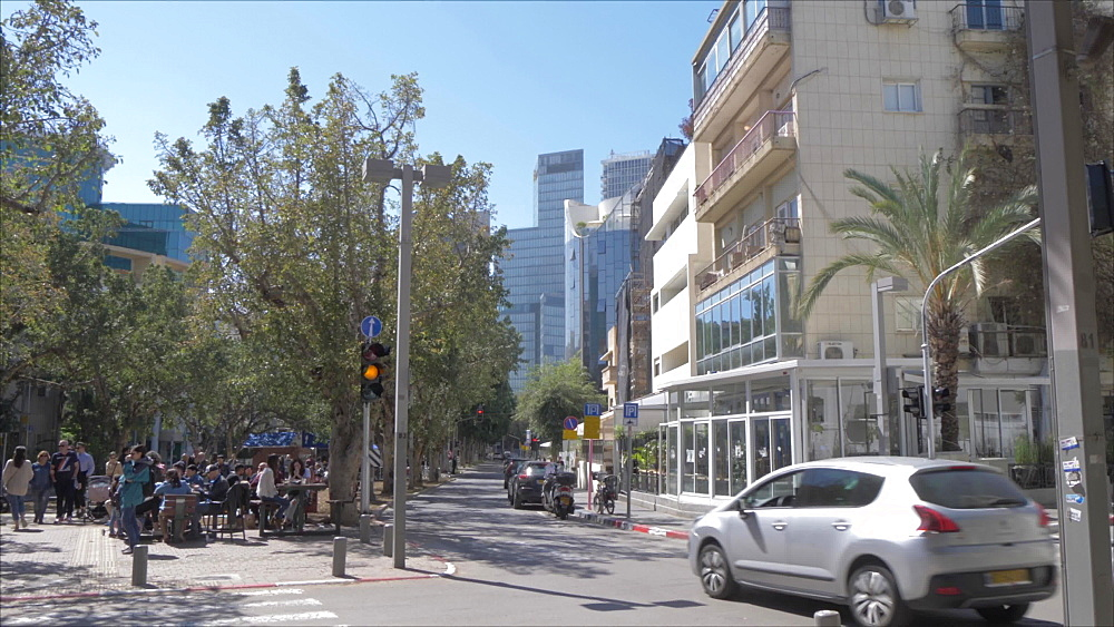 Pan shot of architecture and activities on Rothschild Boulevard, Tel Aviv, Israel, Middle East