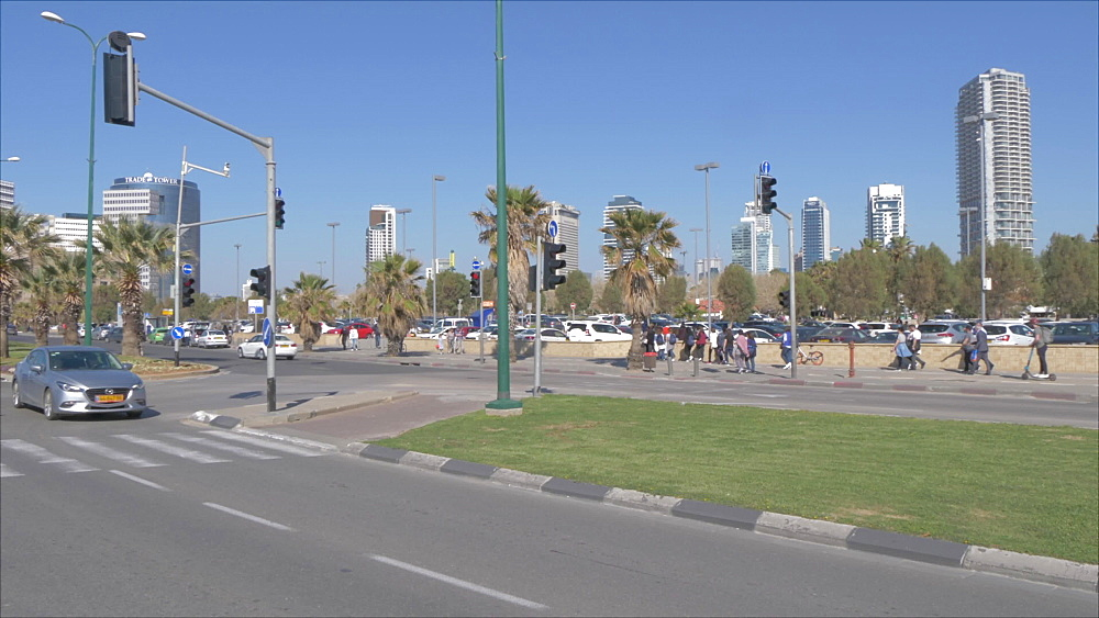 Traffic on Kaufmann Street and city backdrop, Tel Aviv, Israel, Middle East