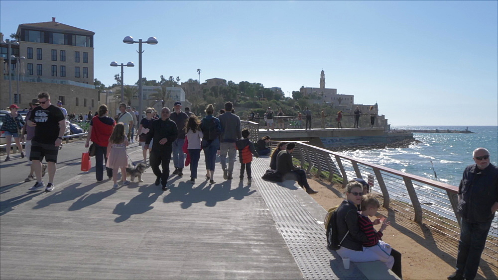 Busy promenade and Jaffa Old Town backdrop, Tel Aviv, Israel, Middle East