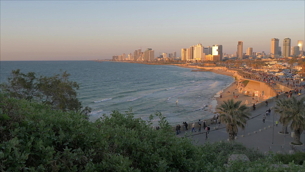 Pan shot of sea and Tel Aviv skyline at sunset from Old Jaffa Town, Tel Aviv, Israel, Middle East