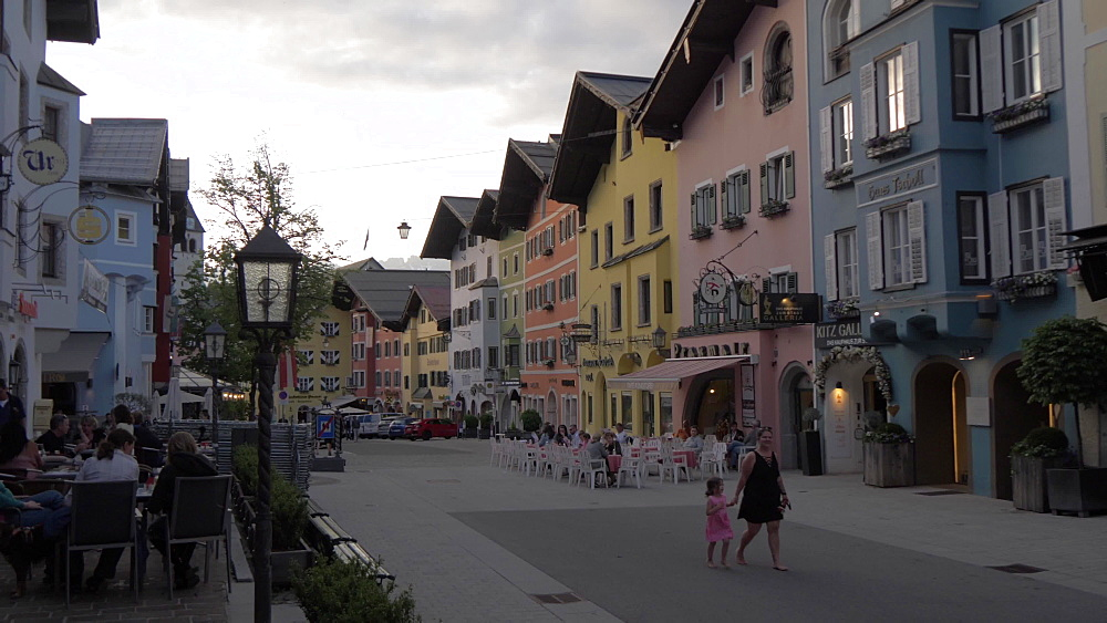 Cafes and colourful buildings in Vorderstadt at dusk, Kitzbuhel, Tyrol, Austrian Alps, Austria, Europe