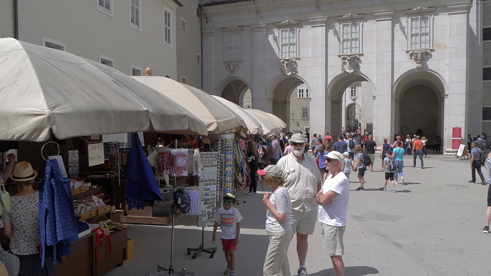 Shot through Kapitelplatz market stalls, Hohensalzburg Castle visible, UNESCO World Heritage Site, Salzburg, Austria, Europe