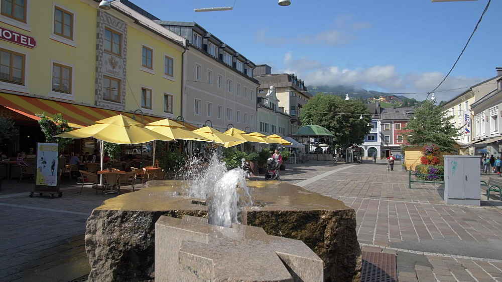 Shops, water fountain and buildings on Hauptplatz, Schladming, Styria, Austrian Alps, Austria, Europe