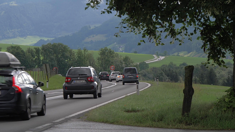 Traffic on busy road near Grobming, Styria, Austrian Alps, Austria, Europe