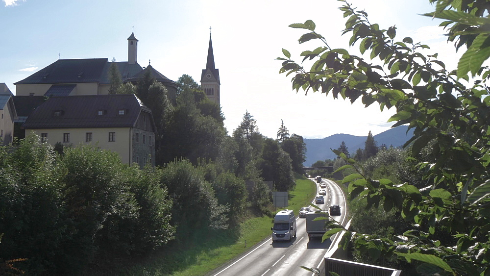 Mary Immaculate Conception Church and busy through road in Radstadt town, Radstadt, Salzburg, Austrian Alps, Austria, Europe