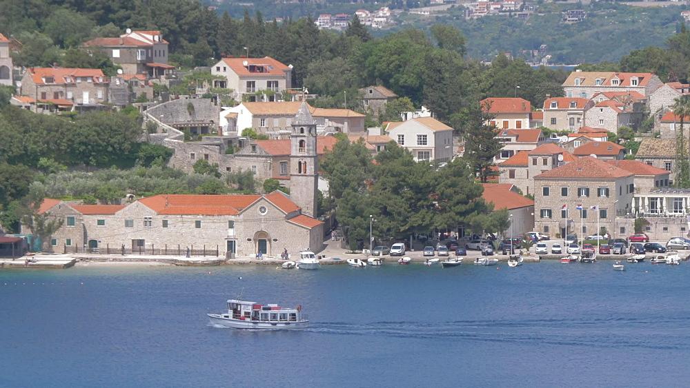 Boat leaving Cavtat and boats in the bay, Cavtat, Dubrovnik Riviera, Croatia, Europe