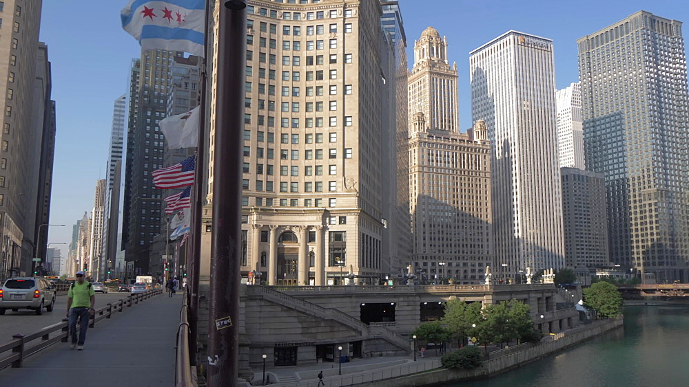 Traffic on DuSable Bridge and tall buildings lining the Chicago River, Chicago, Illinois, United States of America, North America