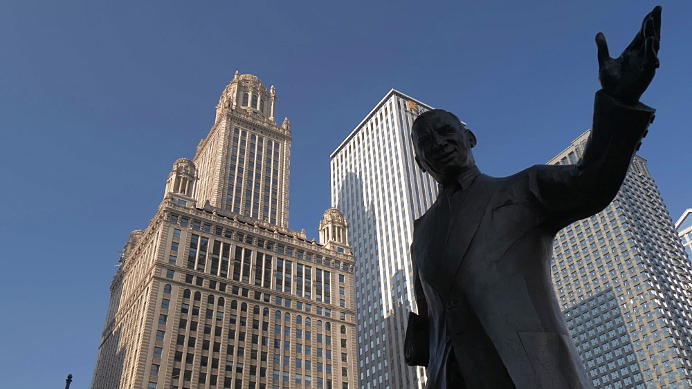 Irv Kupcinet statue and tall buildings lining the Chicago River, Chicago, Illinois, United States of America, North America