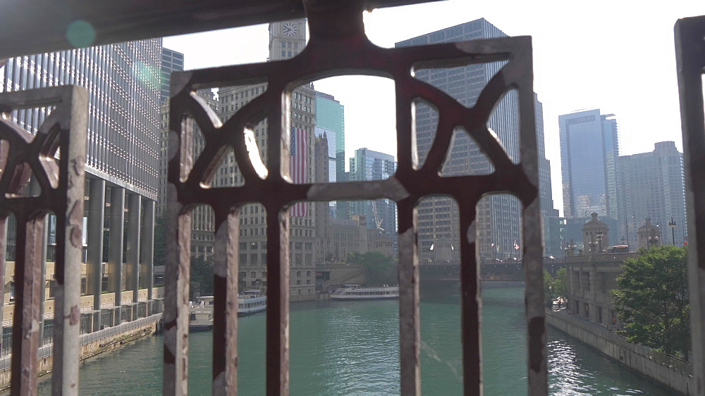 Shot through bridge railings on Chicago River and tall buildings, Chicago, Illinois, United States of America, North America
