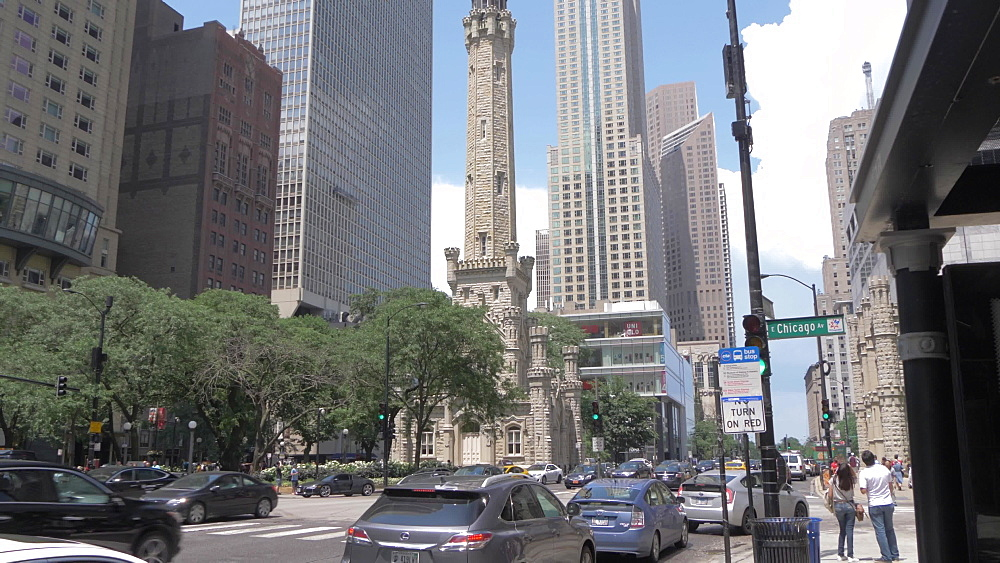 Yellow cab, traffic and the Water Tower on Michigan Avenue, Chicago, Illinois, United States of America, North America