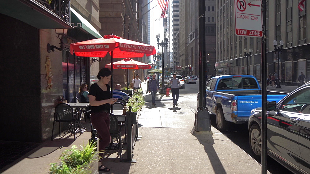 People and buildings on Adams Street, Chicago, Illinois, United States of America, North America