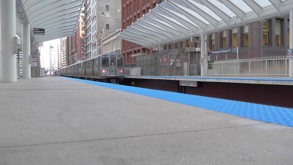 Loop train leaving station, Chicago, Illinois, United States of America, North America