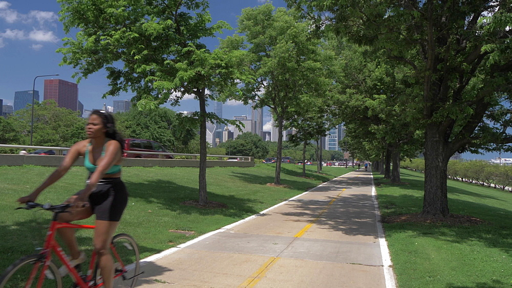 Cyclists on Lake Front Trail and the Chicago Downtown skyline from Museum Campus, Chicago, Illinois, United States of America, North America