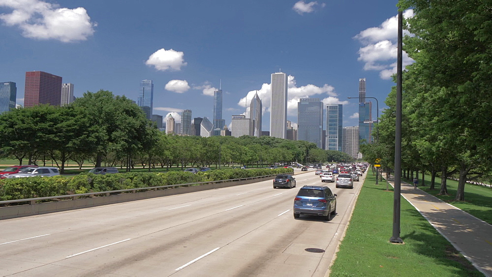 Traffic on South Lake Drive and the Chicago Downtown skyline from Museum Campus, Chicago, Illinois, United States of America, North America