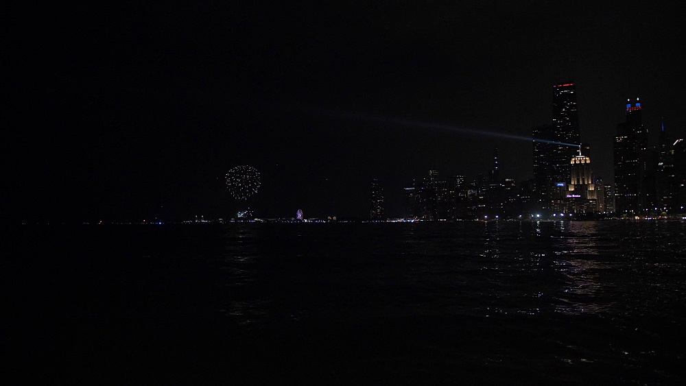 Chicago skyline and 4th July fireworks on Navy Pier from North Shore at night, Chicago, Illinois, United States of America, North America