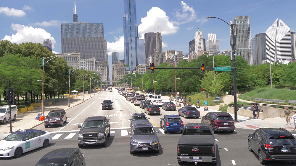 Onboard open top bus shot of city streets of Chicago including city skyline, Chicago, Illinois, United States of America, North America