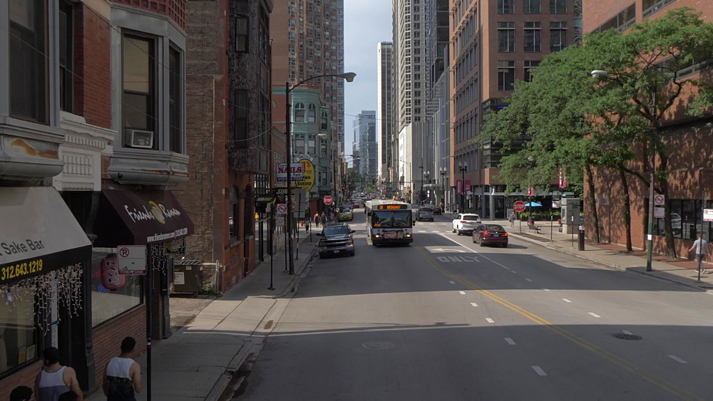 Onboard open top bus shot of bus on city streets, Chicago, Illinois, United States of America, North America