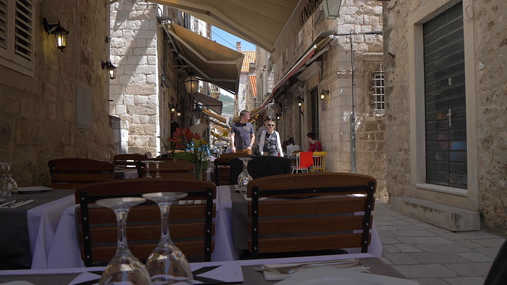 Shot through al fresco restaurants on Prijeko, Dubrovnik Old Town, UNESCO World Heritage Site, Dubrovnik, Dubrovnik Riviera, Croatia, Europe