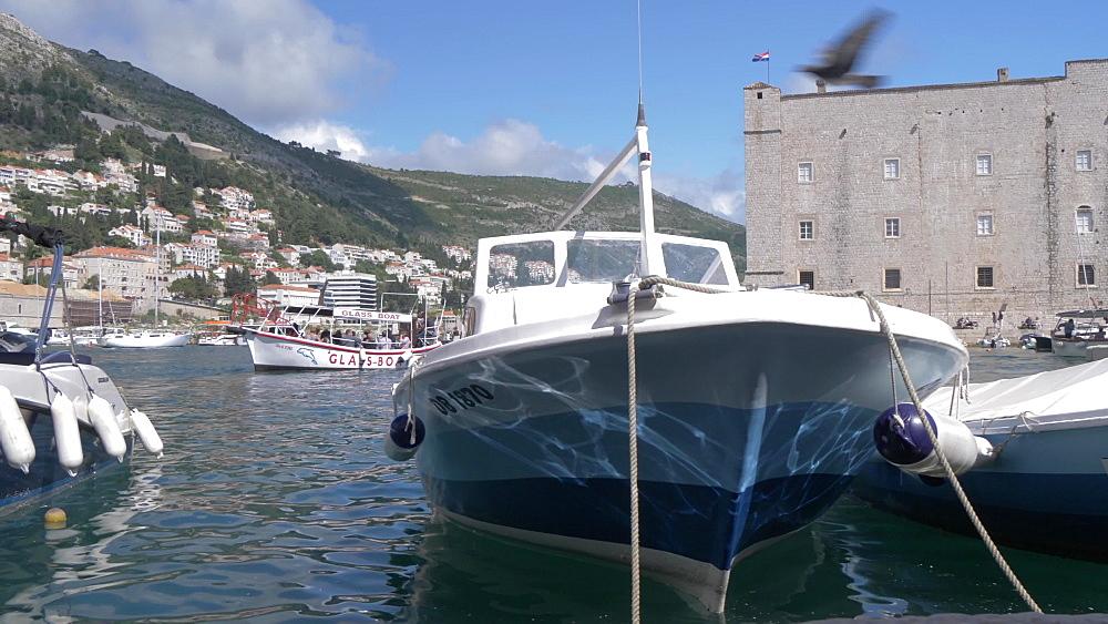 Boats at harbour side in Dubrovnik Old Town Harbour, UNESCO World Heritage Site, Dubrovnik, Dubrovnik Riviera, Croatia, Europe