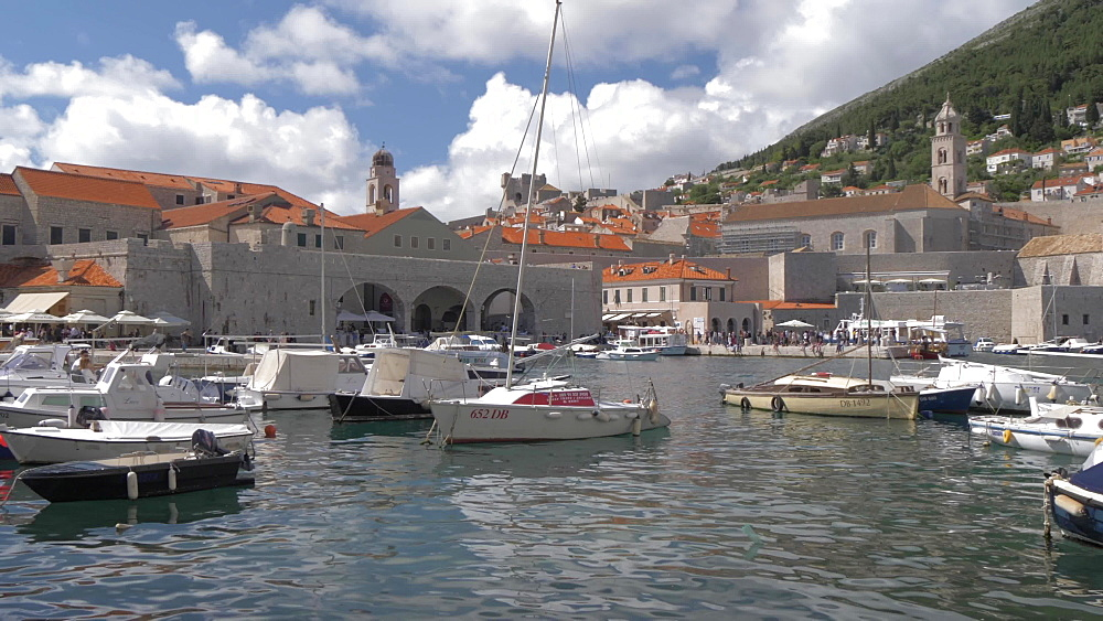 Boats leaving and entering Old Town Harbour, UNESCO World Heritage Site, Dubrovnik, Dubrovnik Riviera, Croatia, Europe