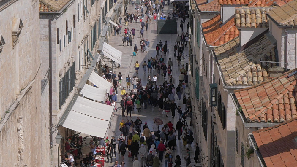 People on Stradun and rooftops from city wall, Dubrovnik Old Town, UNESCO World Heritage Site, Dubrovnik, Dubrovnik Riviera, Croatia, Europe
