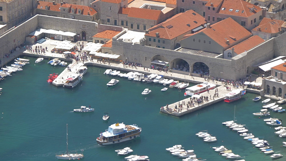 Boat entering Dubrovnik Old Town and Harbour, UNESCO World Heritage Site, from Fort Imperial, Dubrovnik, Dubrovnik Riviera, Croatia, Europe