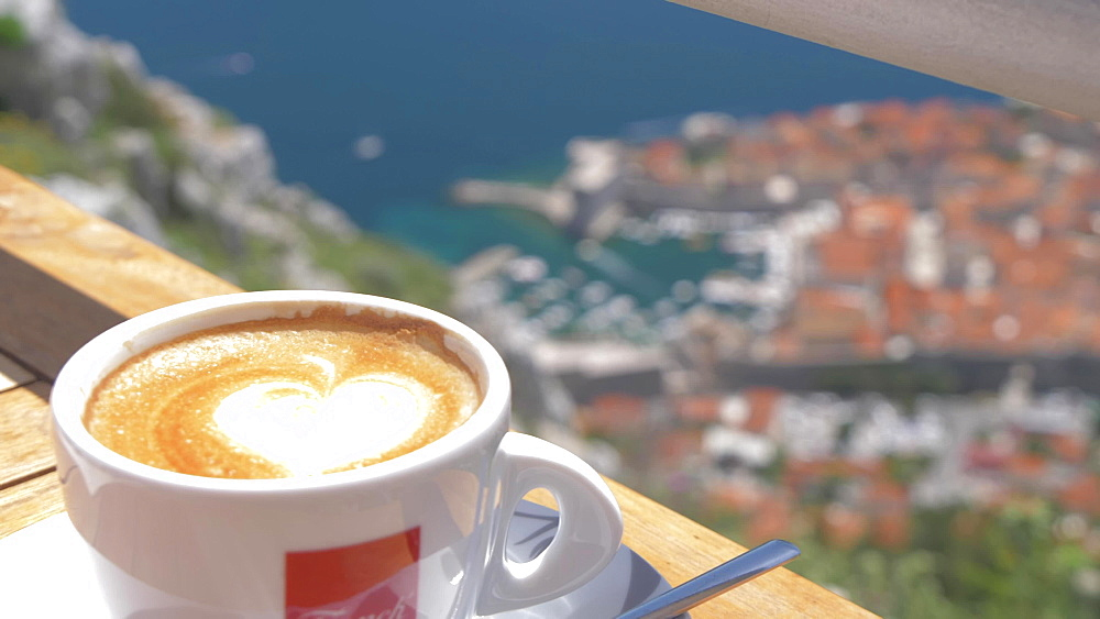 Bay and Dubrovnik Old Town and Harbour with coffee cup from Fort Imperial, Dubrovnik, Dubrovnik Riviera, Croatia, Europe