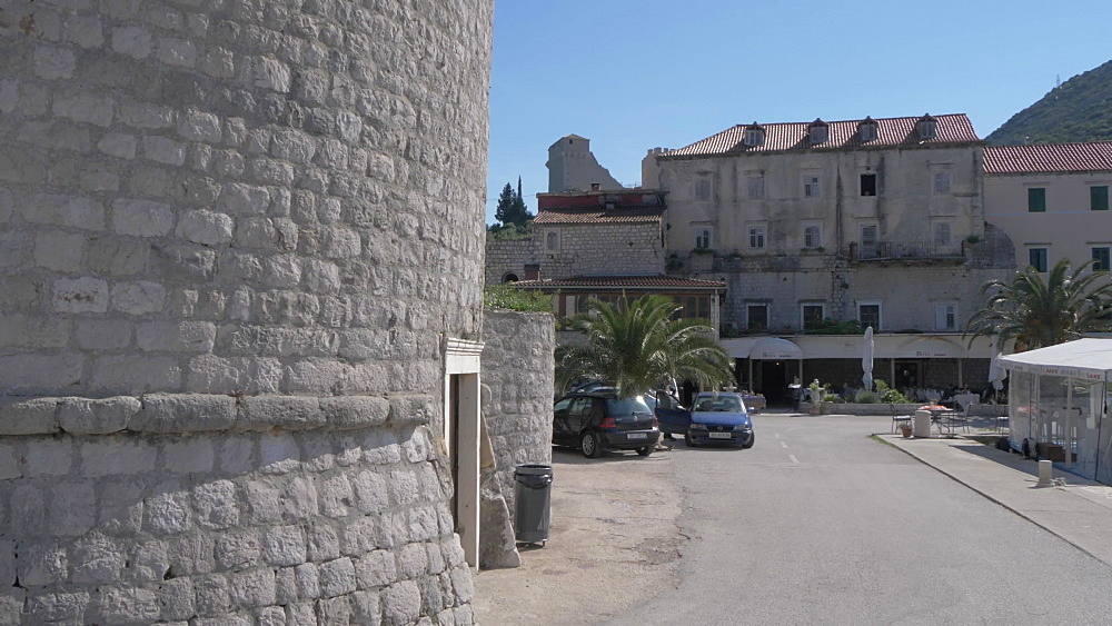 Fortress and harbour front cafes at Mali Ston, Dubrovnik-Neretva, Croatia, Europe