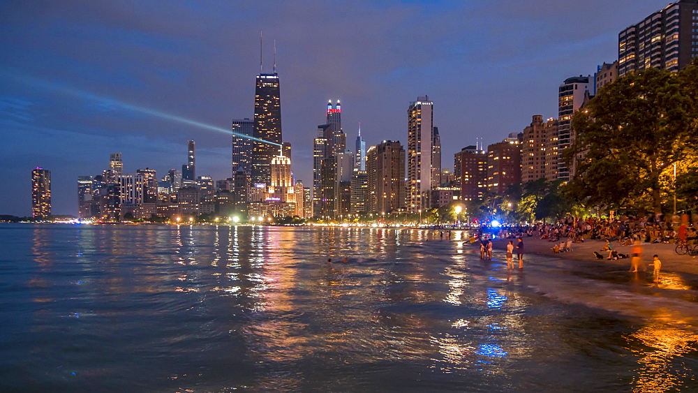 Time lapse of Chicago skyline and Lake Michigan at night, Chicago, Illinois, United States of America, North America