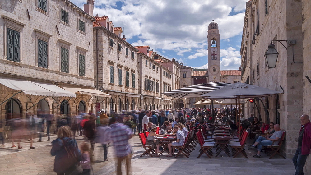 Time lapse of people in Luza Square, Sponza Palace and clock tower, Dubrovnik, Dubrovnik-Neretva, Croatia, Europe