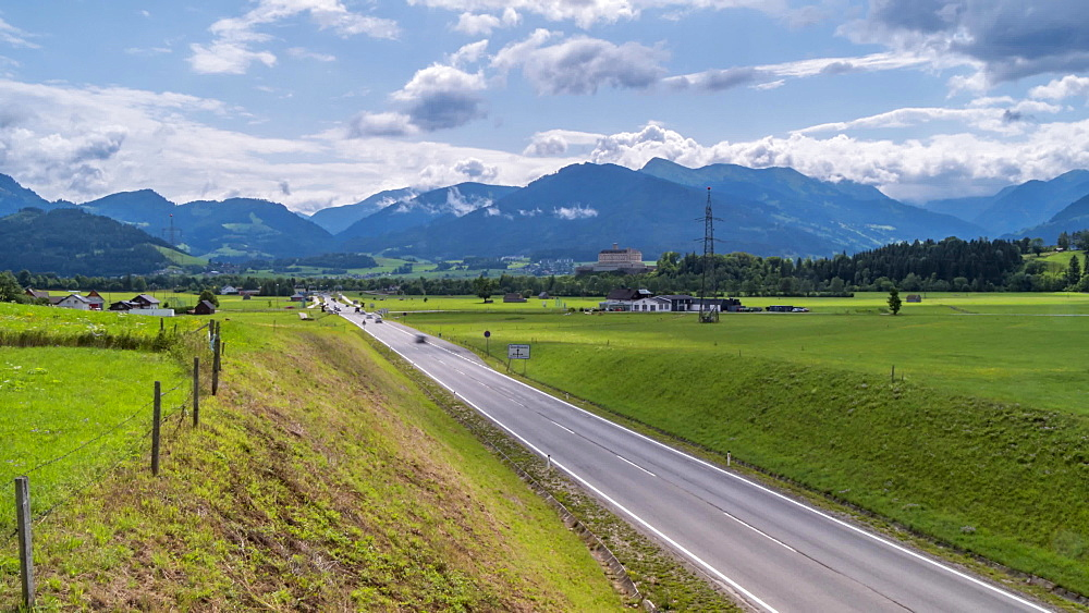 Time lapse of clouds, busy road and Trautenfels Castle, Styria, Austrian Alps, Austria, Europe
