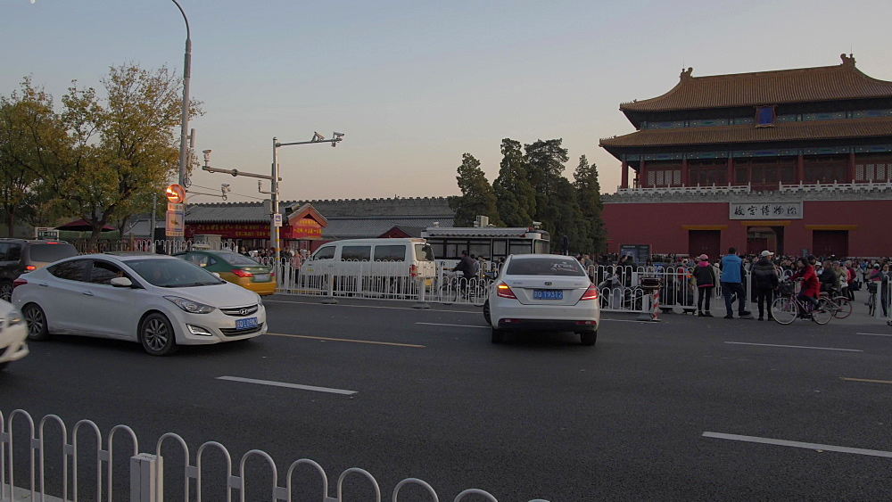 Traffic and the Forbidden City from Jingshan Park at sunset, Beijing, China, Asia