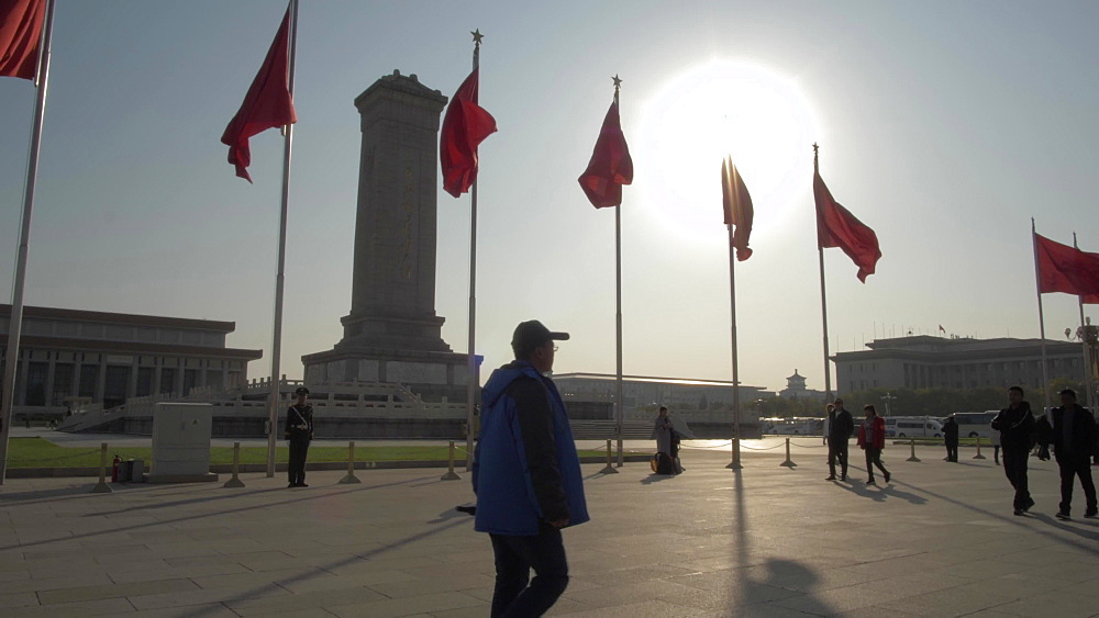 Monument to the People's Heroes and flags in Tiananmen Square, Beijing, People's Republic of China, Asia