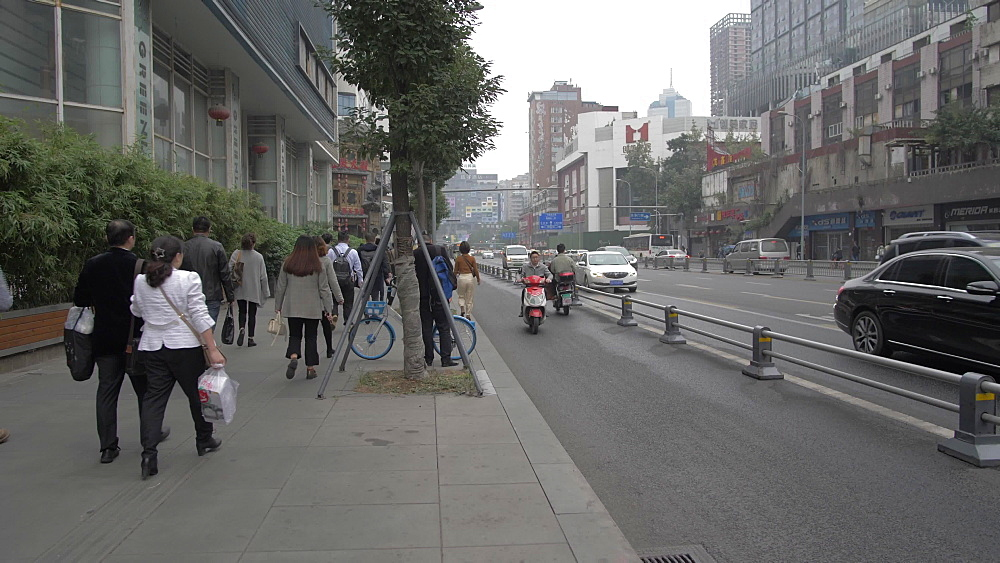 Cyclists and traffic on busy road, Chengdu, Sichuan, People's Republic of China, Asia