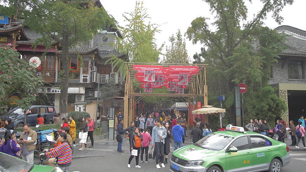 Taxis and entrance to Kuanxiangzi Alley in Chengdu, Sichuan Province, People's Republic of China, Asia