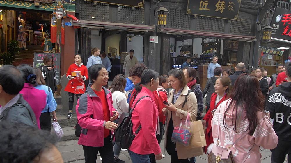 Crane shot of street food and busy shopping street in Ciqikou Old Town, Shapingba, Chongqing, China, Asia
