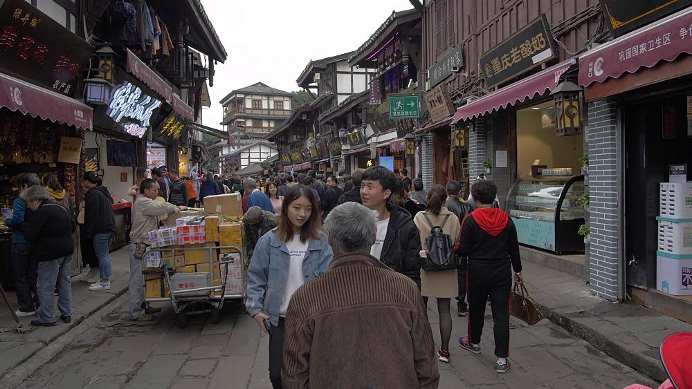 Pan shot of busy shopping street in Ciqikou Old Town, Shapingba, Chongqing, China, Asia