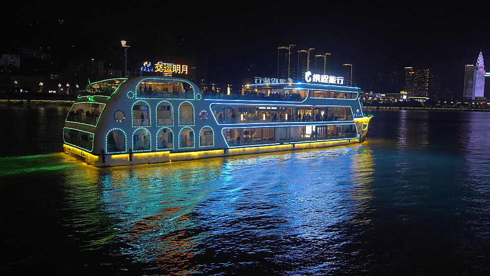 Illuminated cruise boats and Masangxi Bridge on Yangtze River in Chongqing, Yuzhong District, China, Asia