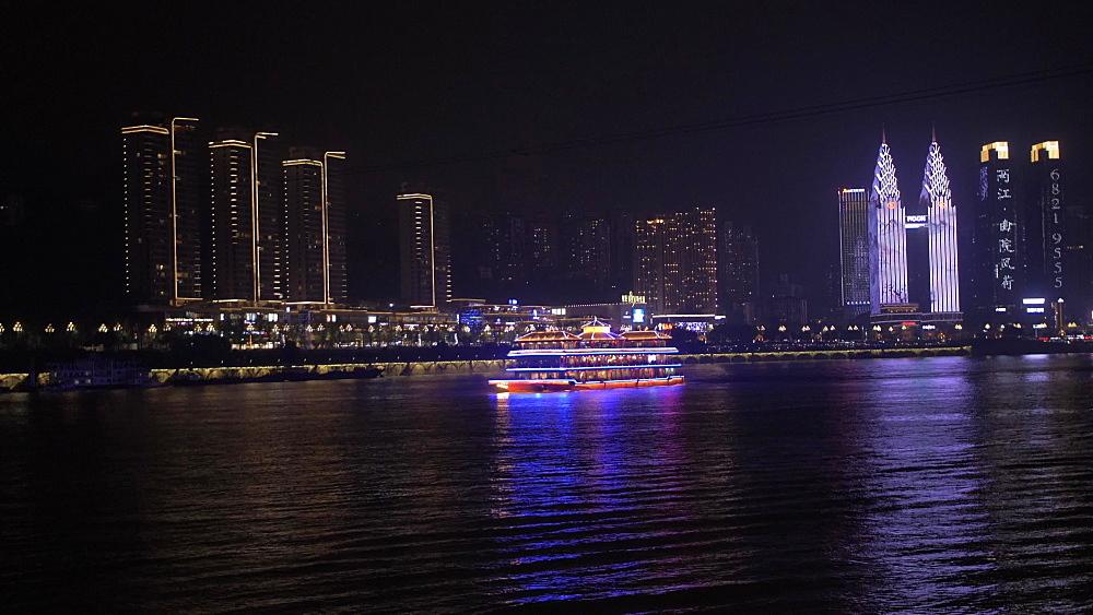 Illuminated cruise boats on Yangtze River in Chongqing, Yuzhong District, China, Asia