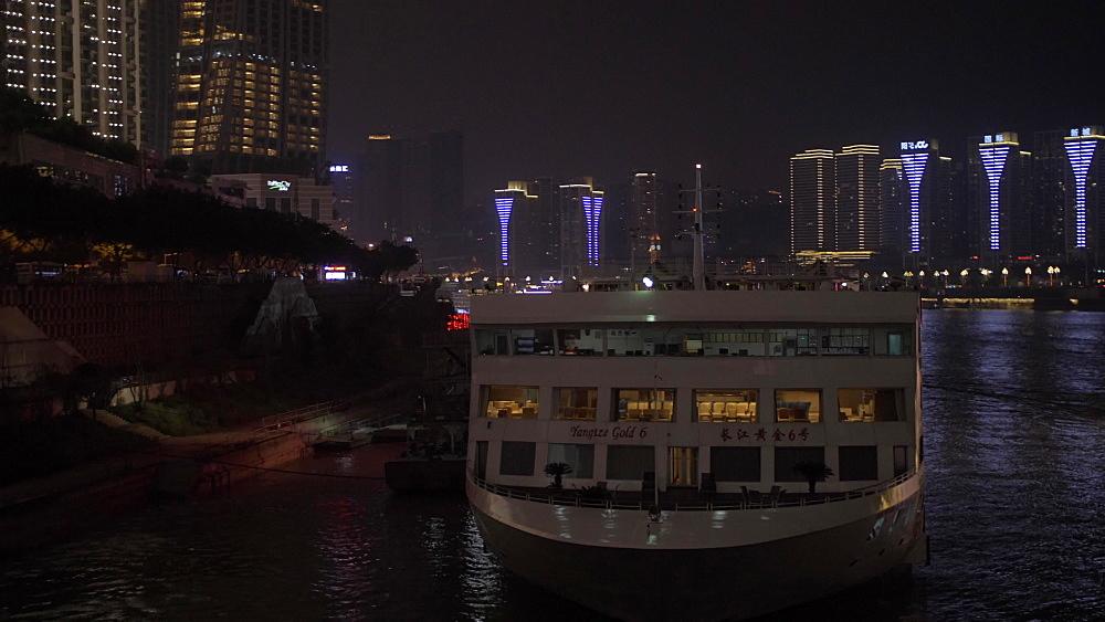 Illuminated cruise boat and Masangxi Bridge on Yangtze River in Chongqing, Yuzhong District, China, Asia