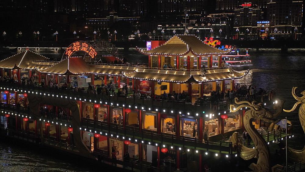 Illuminated cruise boat on Yangtze River in Chongqing, Yuzhong District, China, Asia