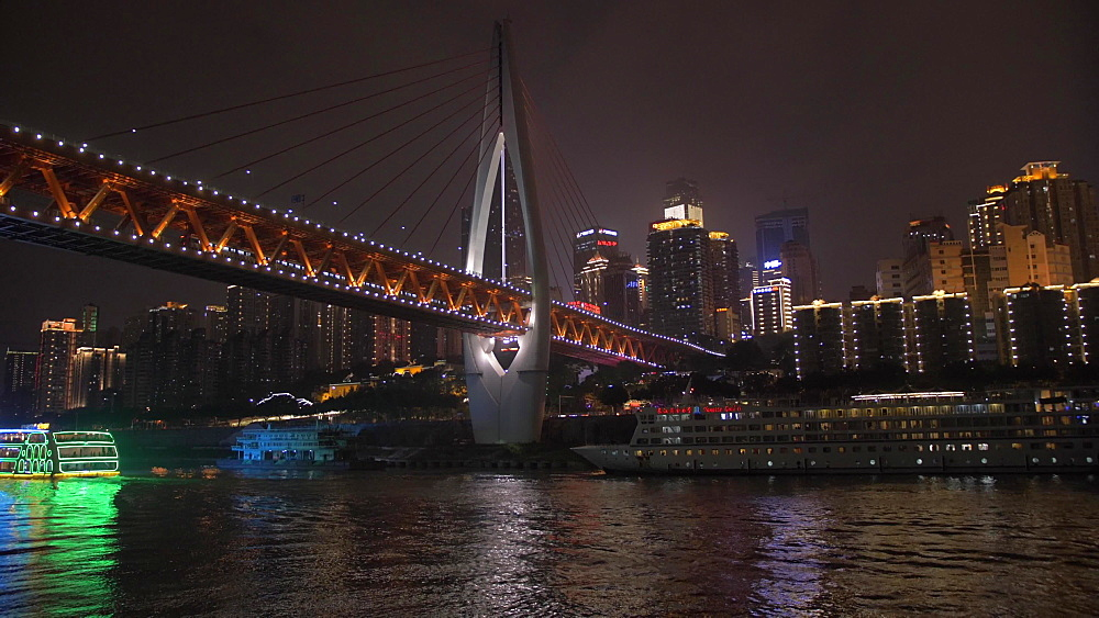 Onboard cruise boat shot of Masangxi Bridge and city skyline at night, Chongqing, Yuzhong District, China, Asia