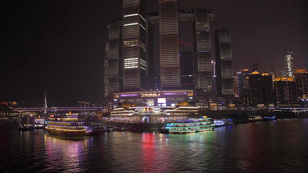 Onboard cruise boat shot of city skyline at night, Chongqing, Yuzhong District, China, Asia