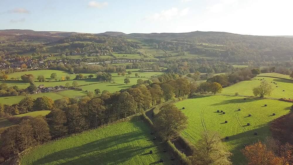 Aerial shot over fields towards Hathersage in autumn, Hathersage, Peak District National Park, Derbyshire, England, United Kingdom, Europe