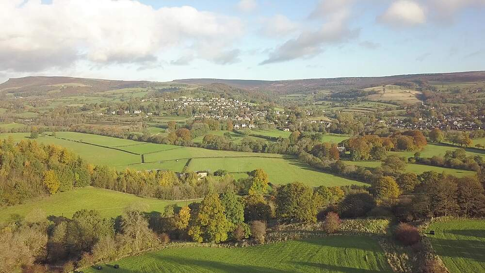 Aerial shot over fields towards Hathersage in autumn, Hathersage, Peak District National Park, Derbyshire, England, United Kingdom, Europe