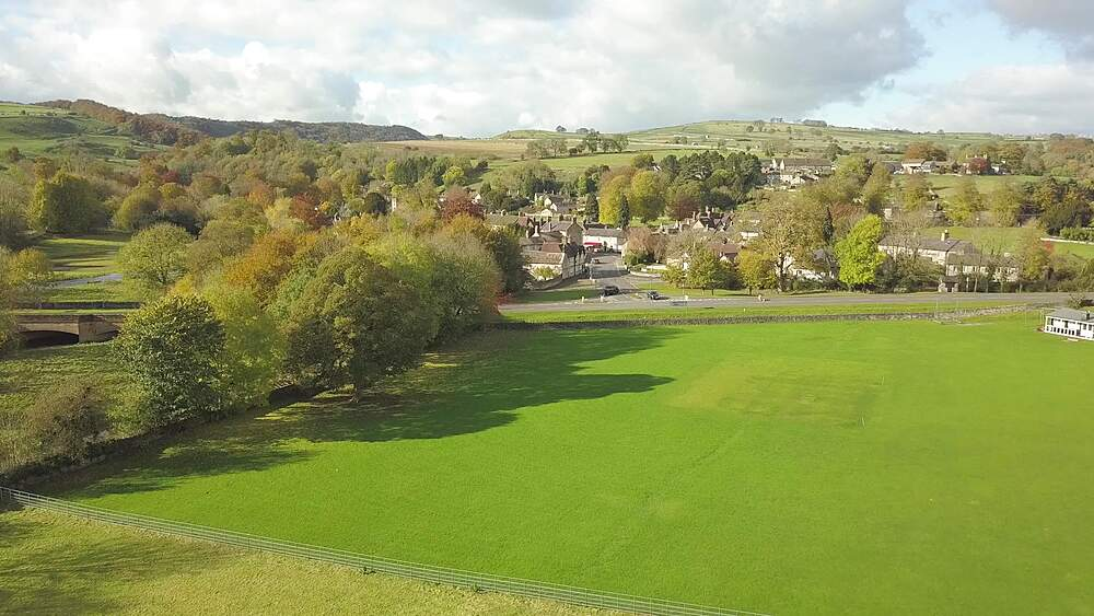 Aerial shot towards Ashford in the water in autumn, Bakewell, Peak District National Park, Derbyshire, England, United Kingdom, Europe