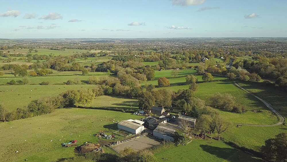 Aerial shot over fields towards Chesterfield in autumn, Derbyshire, England, United Kingdom, Europe
