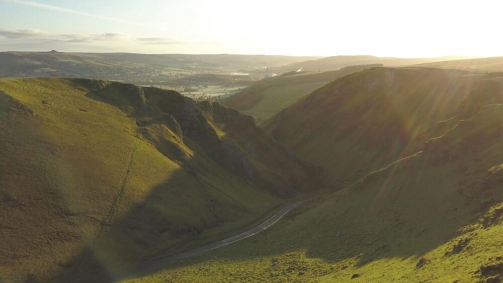 Aerial shot over Winnats Pass at sunrise, Castleton, Hope Valley, Peak District National Park, Derbyshire, England, United Kingdom, Europe