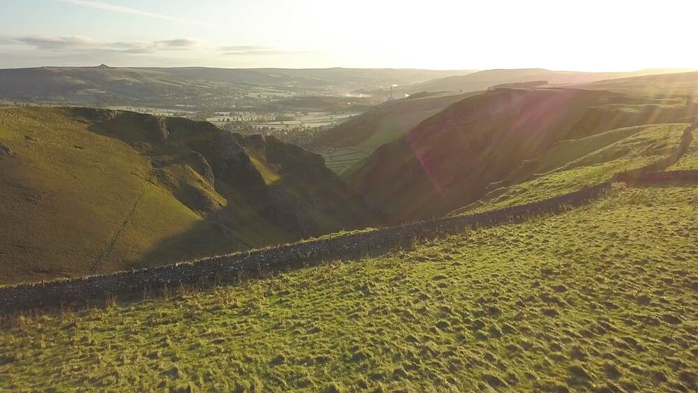 Aerial shot over Winnats Pass at sunrise, Castleton, Hope Valley, Peak District National Park, Derbyshire, England, United Kingdom, Europe