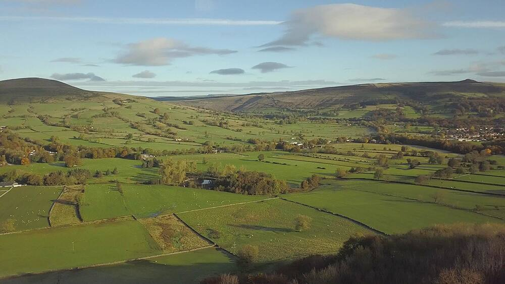 Aerial shot over fields from Castleton to Hope in autumn, Hope Valley, Peak District National Park, Derbyshire, England, United Kingdom, Europe